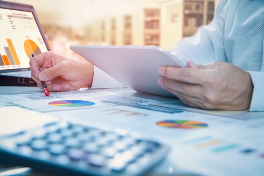 Reviewing a financial report in returning on investment analysis