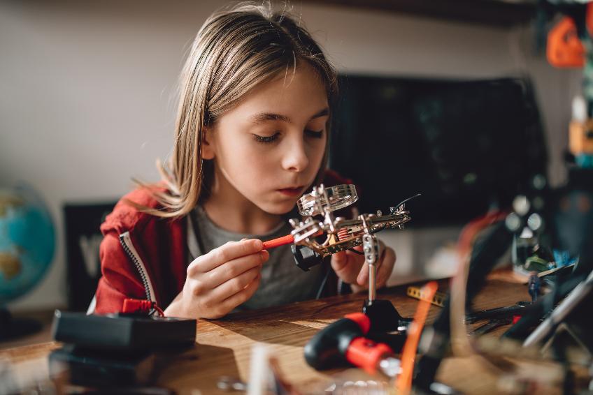 Girl learning robotics