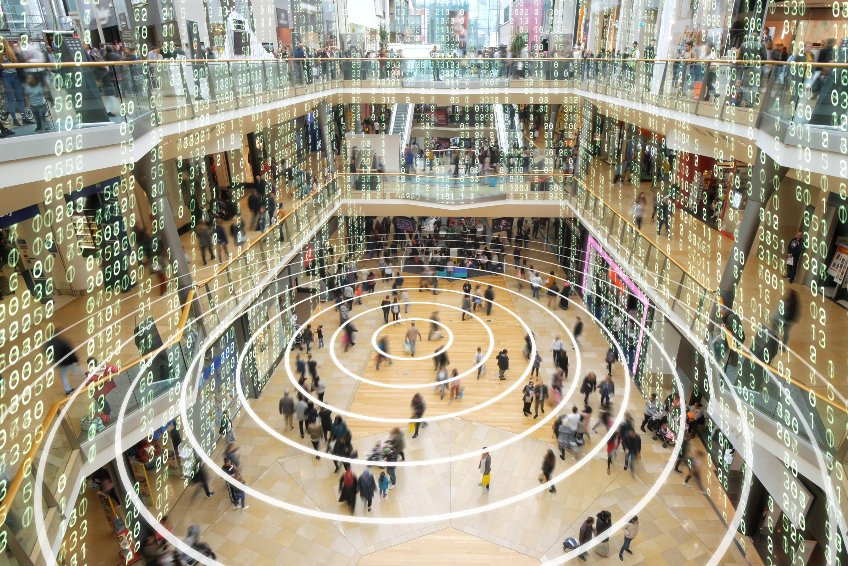 Phone sending out a signal in a matrix styled shopping mall.