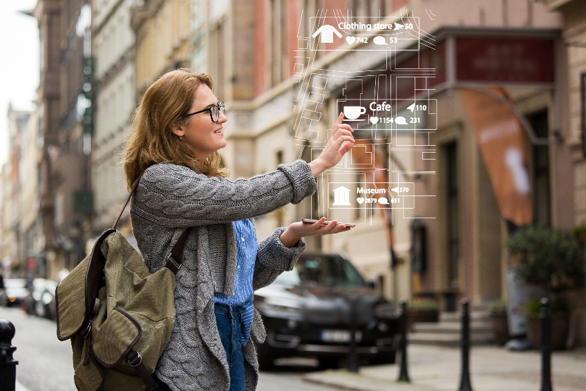 Augmented reality in marketing. Woman traveler with phone.