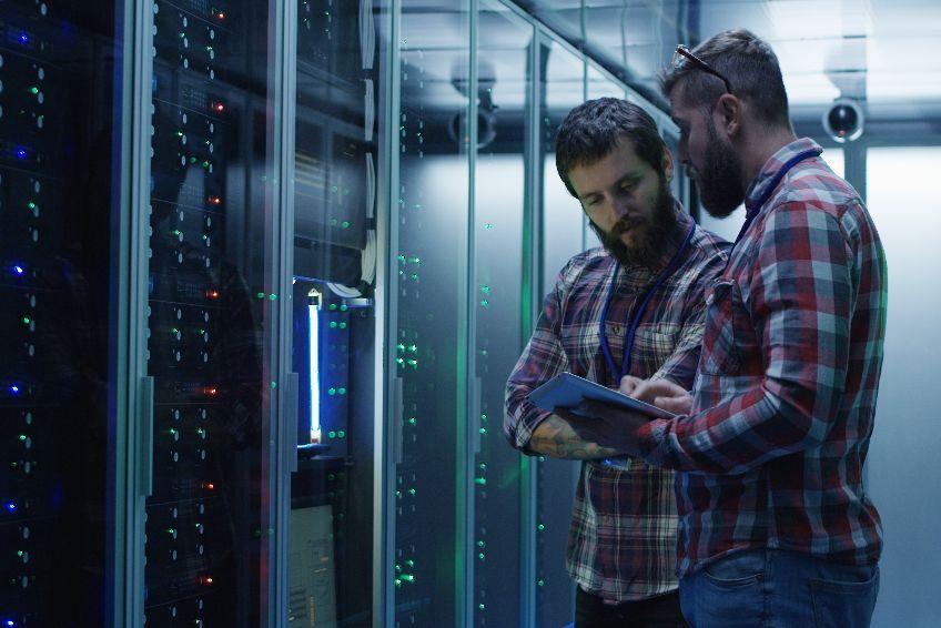 Coworking adult men diagnosing server hardware